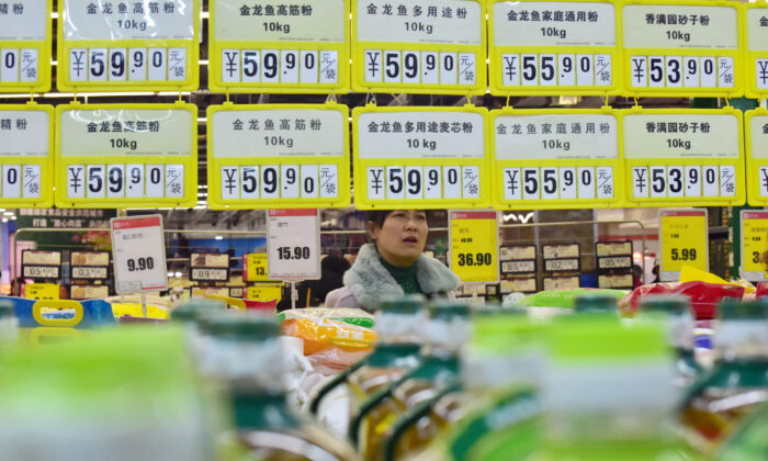 A customer shops at a supermarket in Handan, Hebei Province, China on March 9, 2019. (Reuters)