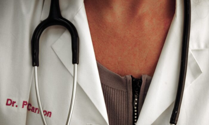 A doctor with stethoscope poses on Oct. 19, 2009 in Manassas, Virginia. (KAREN BLEIER/AFP/Getty Images)