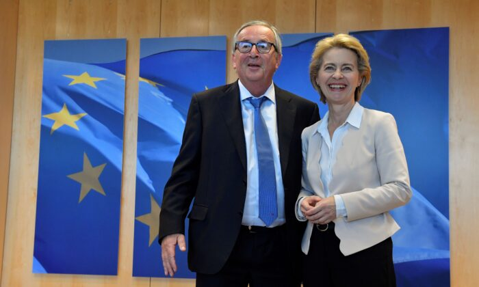 Outgoing President of the European Commission Jean-Claude Juncker (L) welcomes German Defense Minister and newly-appointed EU Commission Chief Ursula von der Leyen in Brussels, Belgium on July 23, 2019, 2019. (John Thys/AFP/Getty Images)