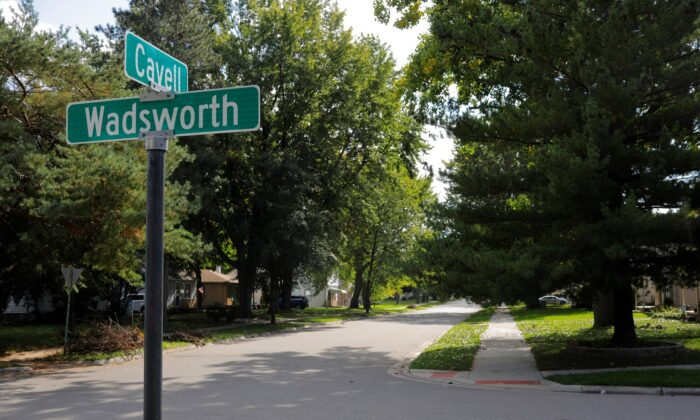 A sign marks Cavell Street in Precinct 25A, where the vote was split 358/358 between Donald Trump and Hillary Clinton in 2016, in Livonia, Michigan, on Oct. 9, 2019.     REUTERS/Brian Snyder