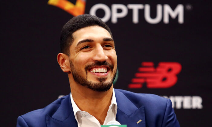 Enes Kanter reacts during a press conference as he is introduced as a member of the Boston Celtics at the Auerbach Center at New Balance World Headquarters in Boston, Massachusetts on July 17, 2019. (Tim Bradbury/Getty Images)