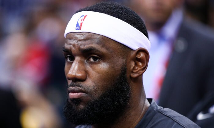 LeBron James #23 of the Los Angeles Lakers looks on before the match against the Brooklyn Nets during a preseason game as part of 2019 NBA Global Games China at Shenzhen Universiade Center in Shenzhen, Guangdong, China on Oct. 12, 2019. (Zhong Zhi/Getty Images)