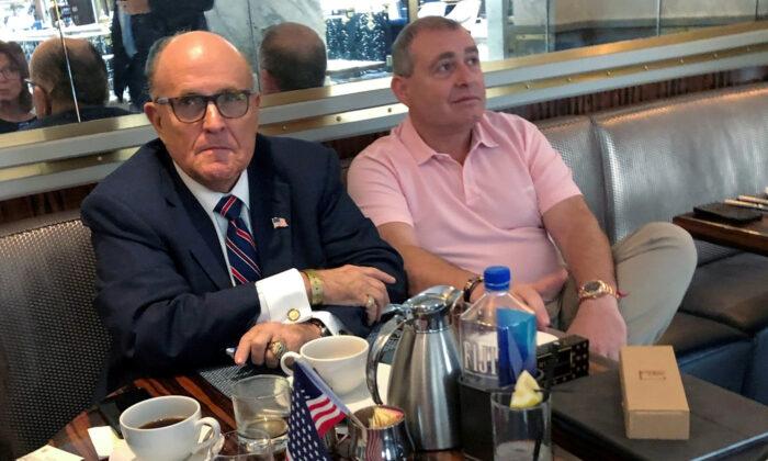 President Donald Trump's personal lawyer Rudy Giuliani has coffee with Ukrainian-American businessman Lev Parnas at the Trump International Hotel in Washington on Sept. 20, 2019. (Aram Roston/File Photo/Reuters)