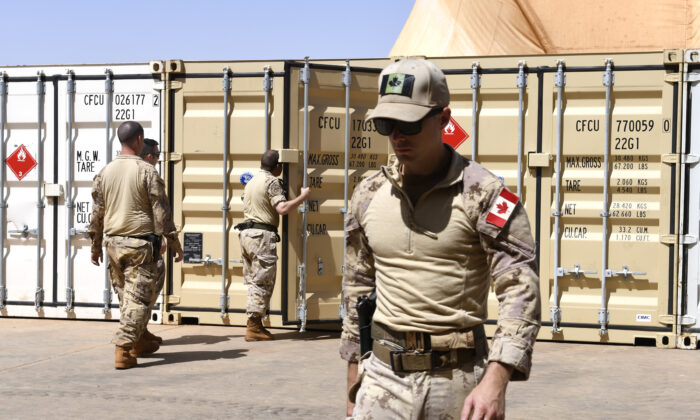 Canadian soldiers unload material at the Castors Camp in Gao, Mali, on Aug. 4, 2018. (Seyllou/AFP/Getty Images)