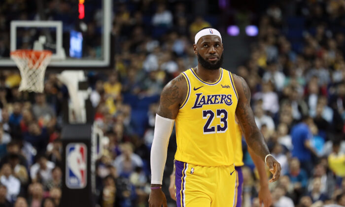 LeBron James #23 of the Los Angeles Lakers reacts during a preseason game against the Brooklyn Nets as part of 2019 NBA Global Games China at Mercedes-Benz Arena on October 10, 2019 in Shanghai, China. Lintao Zhang/Getty Images