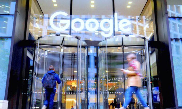 People walk past Google's UK headquarters in London on November 1, 2018. (Tolga Akmen/AFP/Getty Images)