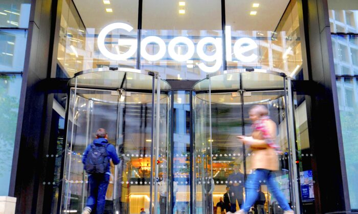 People walk past Google's UK headquarters in London on Nov. 1, 2018. Hundreds of employees walked out of Google's European headquarters in Dublin on Thursday as part of a global campaign over the US tech giant's handling of sexual harassment that saw similar protests in London and Singapore. (TOLGA AKMEN/AFP/Getty Images)