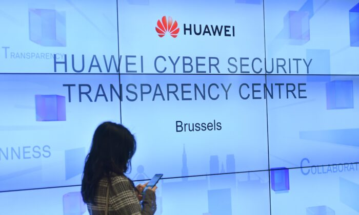 A woman is pictured at an event at Huawei Cybersecurity Center on May 21, 2019 in Brussels. (Emmanuel Dunand/AFP/Getty Images)