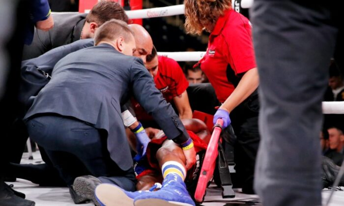 Patrick Day (red trunks) is tended to by paramedics after being knocked out by Charles Conwell (not pictured) during a USBA Super-Welterweight boxing match at Wintrust Arena in Chicago, Illinois, on Oct 12, 2019. (Jon Durr-USA TODAY Sports)