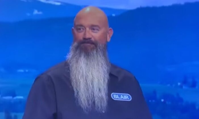 The big-bearded contestant, Blair Davis, from San Diego, said he owned a small trucking business, then went on to describe his family. (Disney/ABC Television Group via CNN)