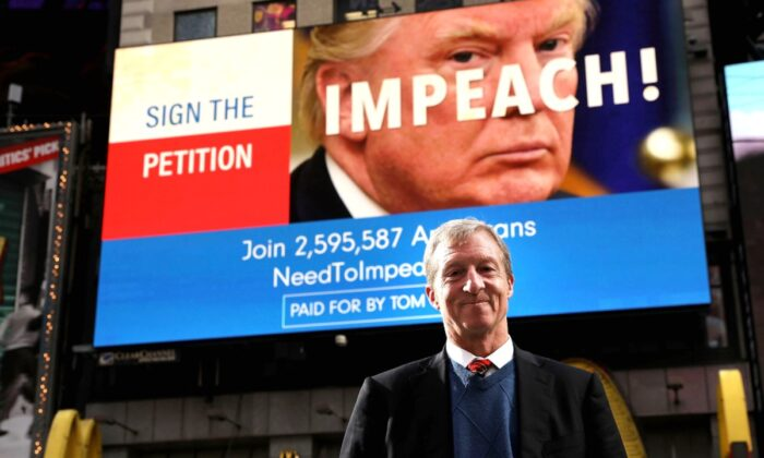 Democratic activist Tom Steyer stands in front of one of the billboards he has funded in Times Square calling for the impeachment of President Donald Trump, in New York City on Nov. 20, 2017. (Spencer Platt/Getty Images)