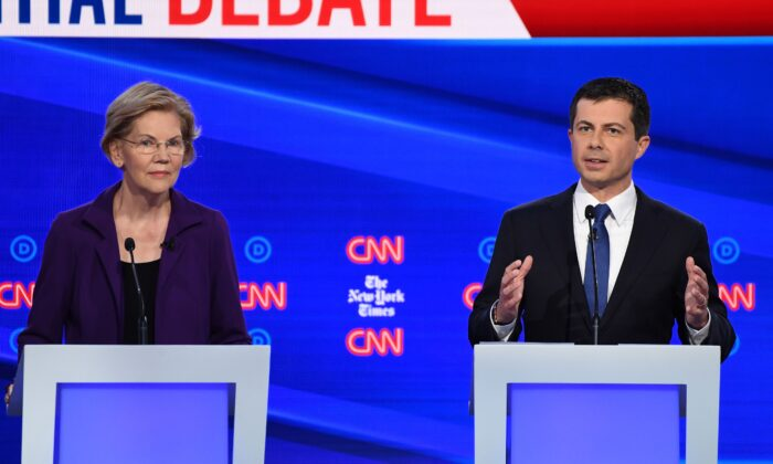 South Bend, Indiana Mayor Pete Buttigieg, right, speaks as Sen. Elizabeth Warren (D-Mass.) looks on during the Democratic Presidential Debate at Otterbein University in Westerville, Ohio on Oct. 15, 2019. (Photo by Win McNamee/Getty Images)