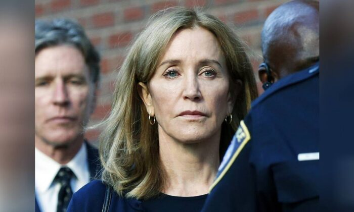 Felicity Huffman leaves federal court with her brother Moore Huffman Jr. following, after she was sentenced in a nationwide college admissions bribery scandal on Sept. 13, 2019, in Boston. (Michael Dwyer/AP)