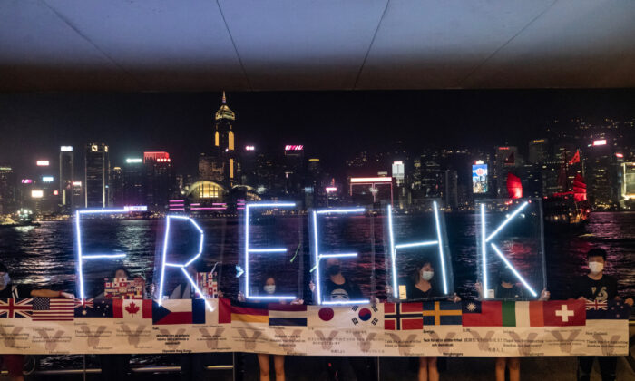 Pro-democracy protesters hold up a Free HK led sign during a Pepe the Frog themed human chain from Tsim Sha Tsui to Prince Edward in Hong Kong, on Sept. 30, 2019. (Anthony Kwan/Getty Images)