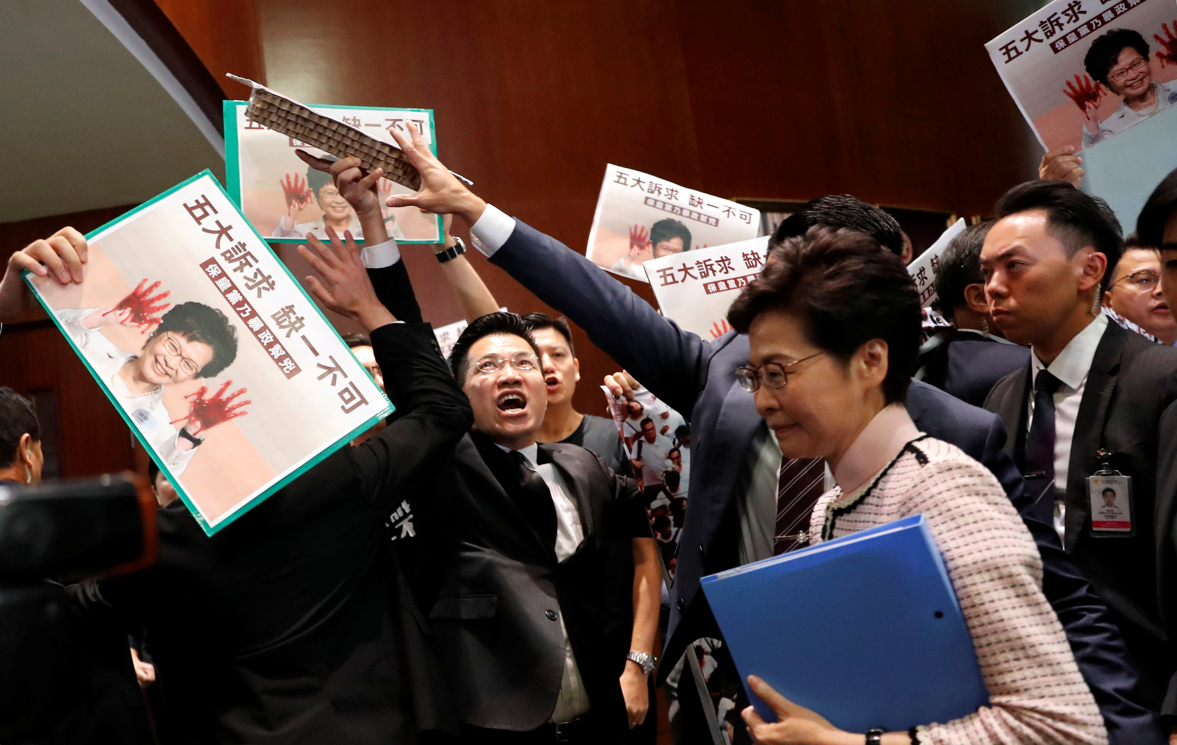 Hong Kong Leader Jeered out of Legislative Council During Policy Speech
