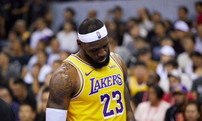 LeBron James reacts during a pre-season game between the Los Angeles Lakers and Brooklyn Nets in Shenzhen, in China's southern Guangdong Province, on Oct. 12, 2019. (STR/AFP via Getty Images)