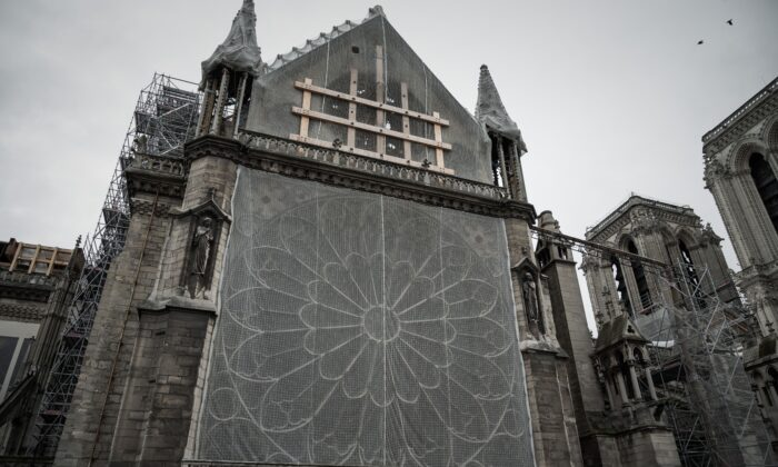 This picture taken on October 15, 2019 shows wood structures, protection nets and scaffolding at the Notre-Dame Cathedral in Paris, six months after the April 15 blaze. (Philippe Lopez/AFP via Getty Images)