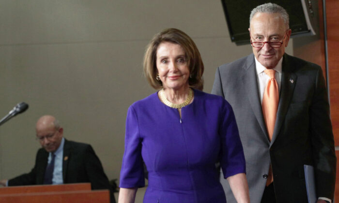 House Speaker Nancy Pelosi (D-Calif.) and Senate Minority Leader Chuck Schumer (D-N.Y.) arrive at a news briefing in Washington on May 22, 2019. (Alex Wong/Getty Images)