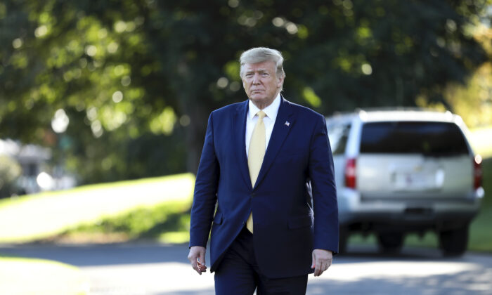 President Donald Trump heading to speak to media before departing the White House on Marine One on Oct. 11, 2019. (Charlotte Cuthbertson/The Epoch Times)
