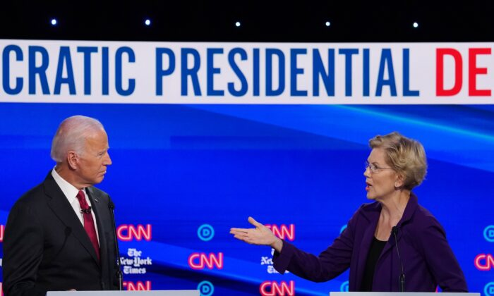 Sen. Elizabeth Warren (D-Mass.) speaks as former Vice President Joe Biden listens during the Democratic Presidential Debate at Otterbein University in Westerville, Ohio on Oct. 15, 2019. (Win McNamee/Getty Images)
