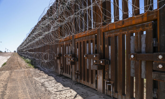 The flood gates sit within the U.S.-Mexico border fence west of Naco, Arizona, on May 8, 2019. (Charlotte Cuthbertson/The Epoch Times)