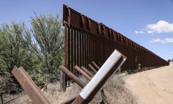 A mix of Normandy vehicle barrier and taller border fence by the San Pedro River on the U.S.-Mexico border near Sierra Vista, Ariz., on May 8, 2019. (Charlotte Cuthbertson/The Epoch Times)