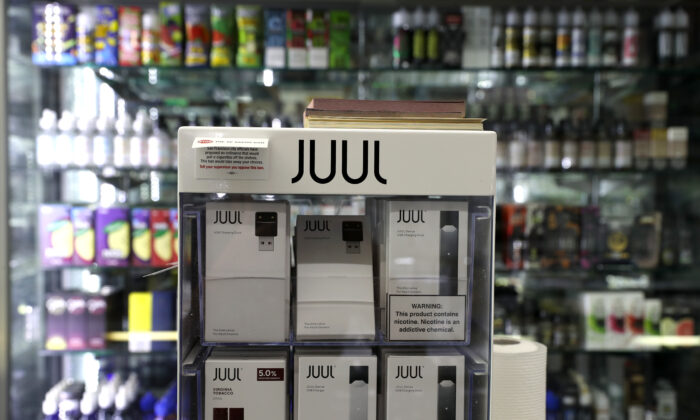 E-Cigarettes made by Juul are displayed at Smoke and Gift Shop on June 25, 2019 in San Francisco, California. (Justin Sullivan/Getty Images)