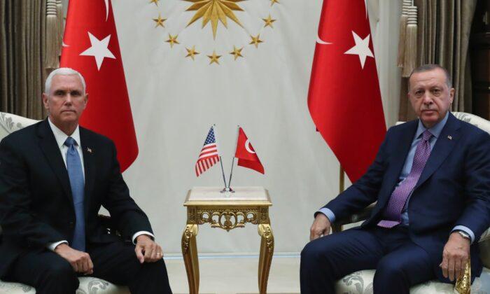 Turkish President Tayyip Erdogan meets with U.S. Vice President Mike Pence at the Presidential Palace in Ankara, Turkey on Oct. 17, 2019. (Murat Cetinmuhurdar/Presidential Press Office/Handout via Reuters)