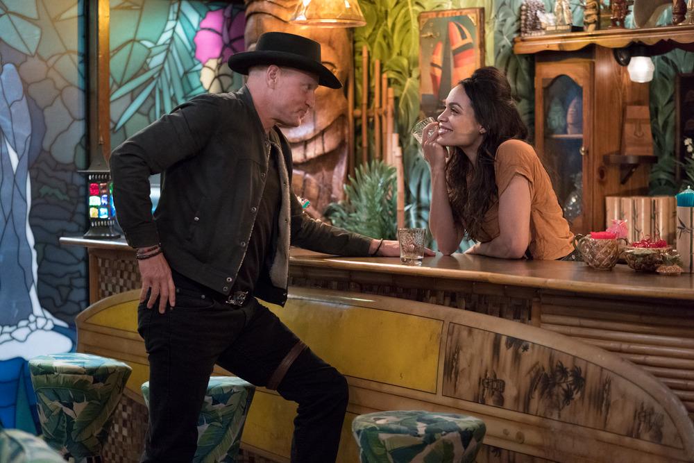 man and female bartender in bar