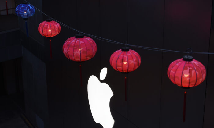 Lanterns hang outside an Apple store in a mall in Beijing, China, on Feb. 23, 2016. (Greg Baker/AFP/Getty Images)