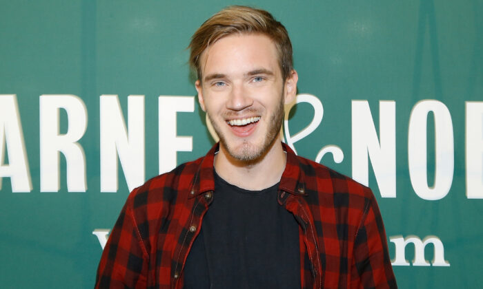 "PewDiePie signs copies of his new book ""This Book Loves You"" at Barnes & Noble Union Square in New York, N.Y., on Oct. 29, 2015. (John Lamparski/Getty Images)"