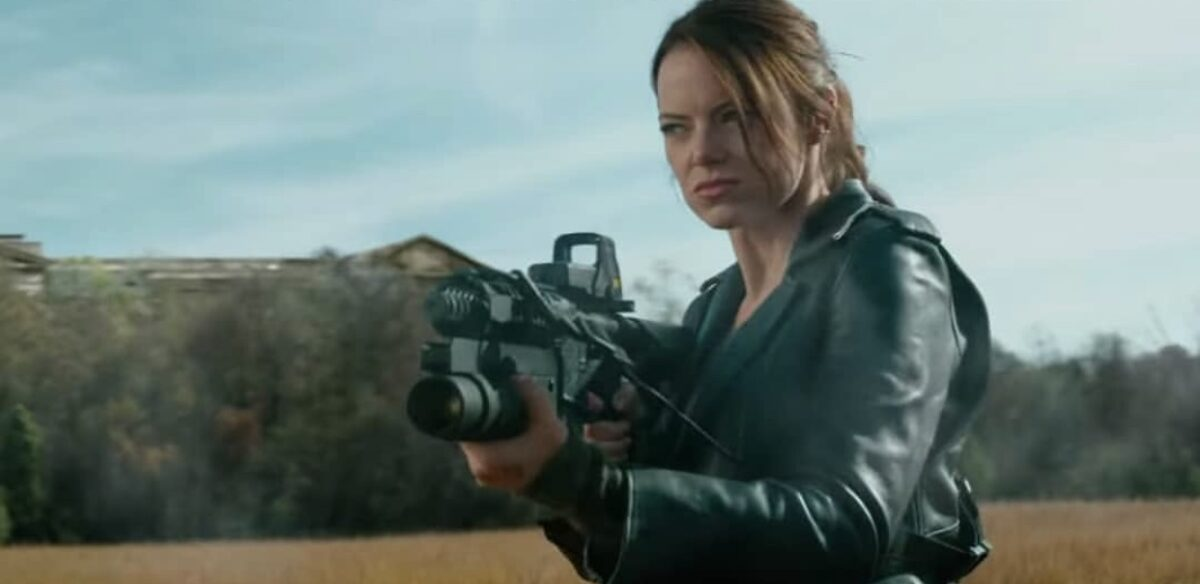 woman in black jacket with grenade launcher