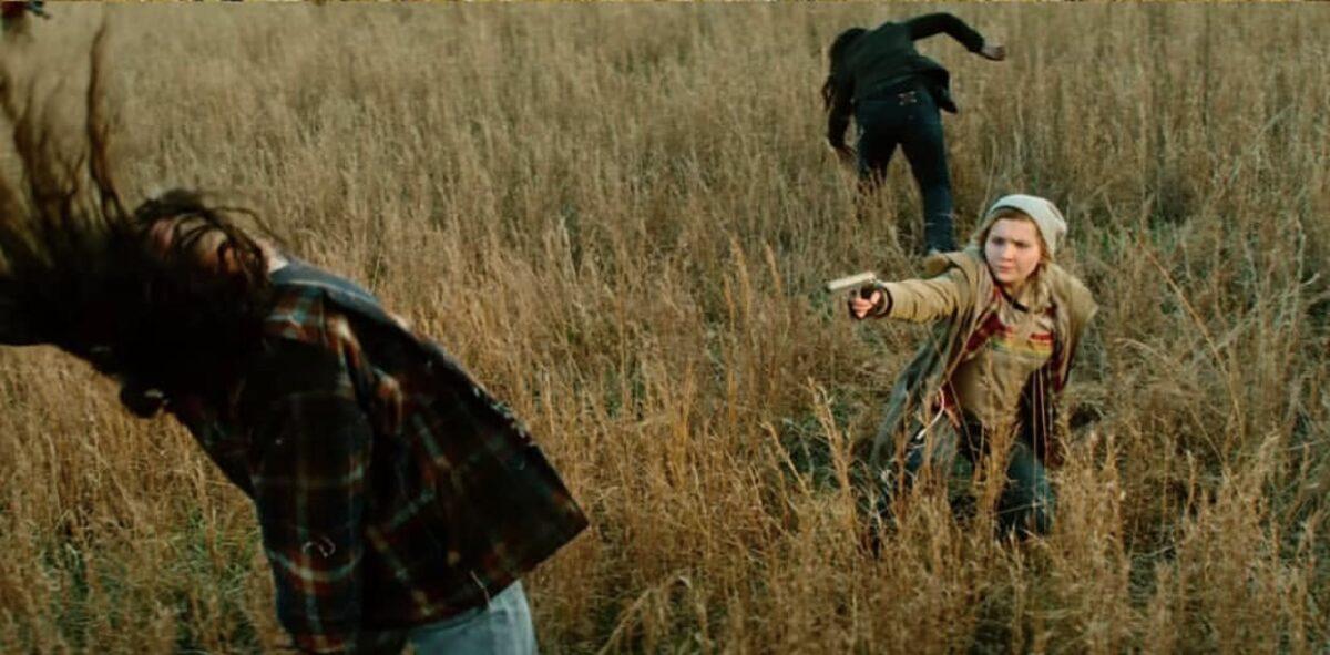 woman shooting zombies with handgun