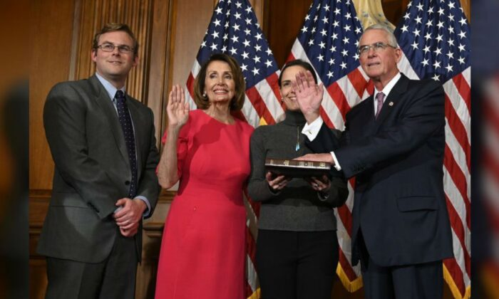 House Speaker Nancy Pelosi (D-Calif.) (second from left) during a ceremonial swearing-in with Rep. Francis Rooney (R-Fla.) (R), on Capitol Hill in Washington on Jan. 3, 2019. (Susan Walsh/AP Photo)
