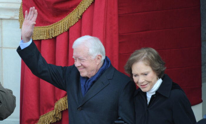 Former president Jimmy Carter and wife Rosayln arrive at the inauguration of Barack Obama as the 44th President of the United States of America on the West Front of the Capitol in Washington on Jan. 20, 2009. (Tim Sloan/AFP/Getty Images)