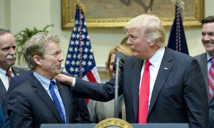 President Trump acknowledges Sen. Rand Paul (R-Ky.) prior to signing H.J. Res. 38, disapproving the rule submitted by the Department of the Interior known as the Stream Protection Rule in the Roosevelt Room of the White House in Washington on Feb. 16, 2017. (Ron Sachs-Pool/Getty Images)