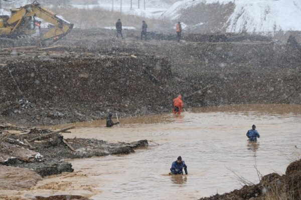 Rescuers work at the scene of the accident following a dam failure in Krasnoyarsk Region