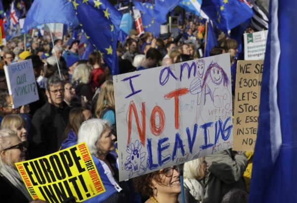 Anti-Brexit supporters carry signs and EU flags during a march in London