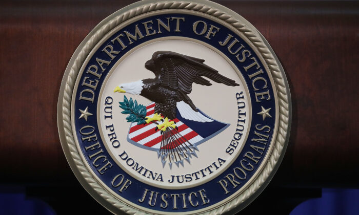 The Justice Department seal is seen on the lectern during a Hate Crimes Subcommittee summit in Washington, on June 29, 2017. (Mark Wilson/Getty Images)