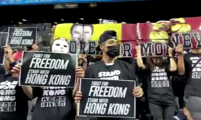 Protesters at an NBA game at the Barclays Center in New York City on Oct. 18, 2019. (NY4HK - NEW YORKERS SUPPORTING HONG KONG via Reuters)