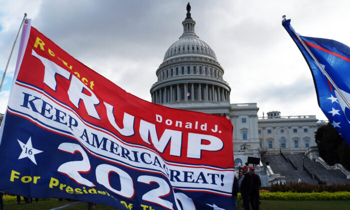 """Supporters of US President Donald Trump hold a """"Stop Impeachment"""" rally in front of the US Capitol Oct. 17, 2019 in Washington, DC. (Olivier Douliery/AFP/AFP via Getty Images)"""