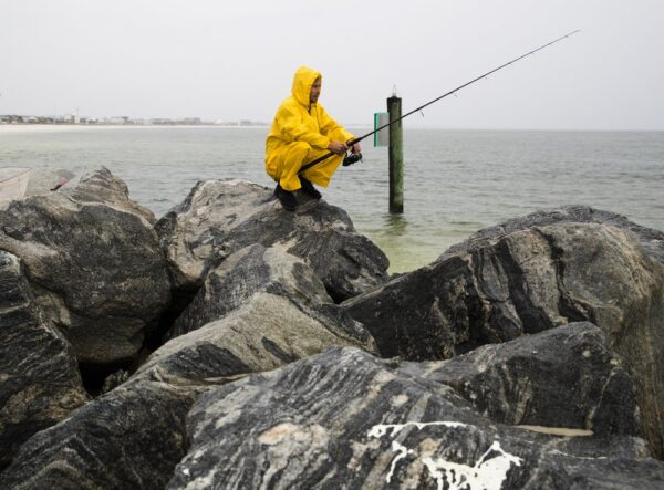 Michael Foster fishes as Tropical Storm Nestor approaches,