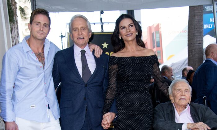 Cameron Douglas, Michael Douglas, Catherine Zeta-Jones and Kirk Douglas attend the ceremony honoring actor Michael Douglas with a Star on Hollywood Walk of Fame, in Hollywood, California on Nov. 6, 2018. (VALERIE MACON/AFP/Getty Images)