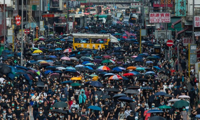 People march along the main road in Mong Kok as they take part in a pro-democracy march from Tsim Sha Tsui in the Kowloon district in Hong Kong on Oct. 20, 2019. (Philip Fong/AFP via Getty Images)