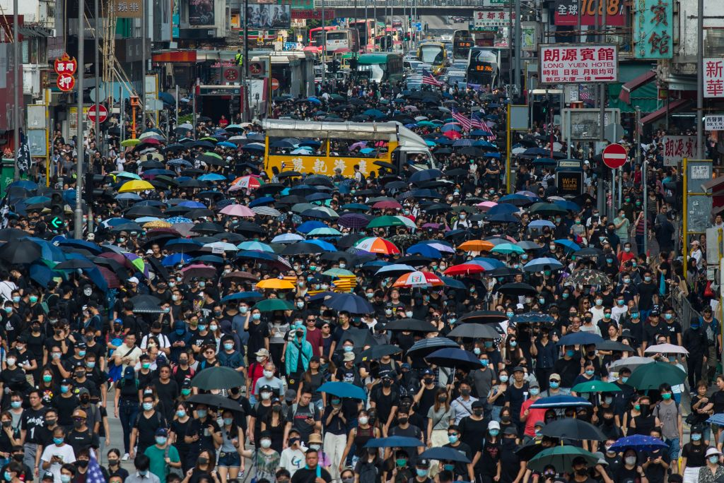 350,000 Hongkongers March Despite Police Ban, Days After Assault on Prominent Activist