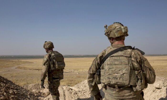 U.S. soldiers survey the safe zone between Syria and the Turkish border near Tal Abyad, Syria, on a joint patrol with the Tax Abyad Military Council, affiliated with the U.S.-backed Syrian Democratic Forces on Sept. 6, 2019. (Maya Alleruzzo/AP Photo)
