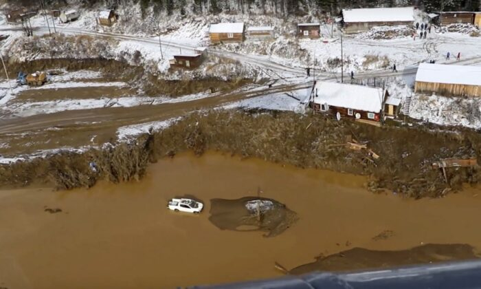 In this image made from video provided by Russian Emergency Situations Ministry press service, a view after the dam collapse during heavy rain on Saturday. (Russian Ministry of Emergency Situations press service via AP))