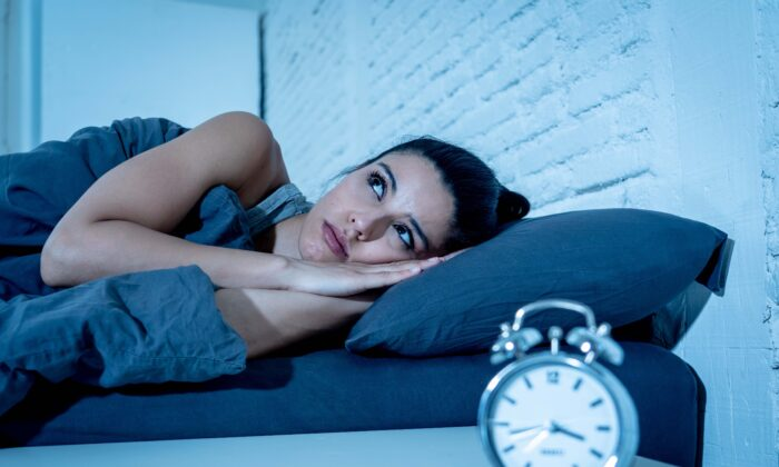 Stewing on a grudge doesn't solve the problem, it just ruins your sleep. (Sam Wordley/Shutterstock)