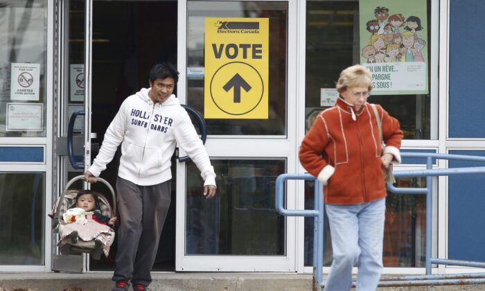 Voters leave the Ecole Marius-Barbeau polling station in Ottawa after casting their votes in the last federal election on Oct. 19, 2015. (THE CANADIAN PRESS/ Patrick Doyle)