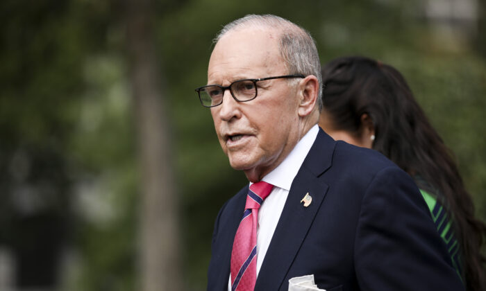White House economic adviser Larry Kudlow talks to media outside the White House in Washington on Sept. 26, 2019. (Charlotte Cuthbertson/The Epoch Times)